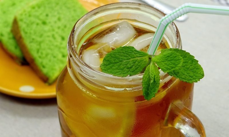 jaggery water topped with mint and ice cubes