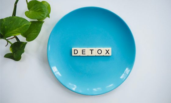 detox written on a blue plate