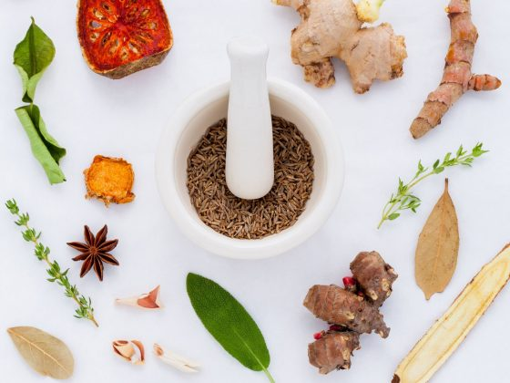 different types of herbs on white floor